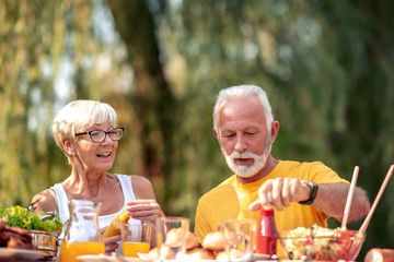 Senior couple have a meal in nature