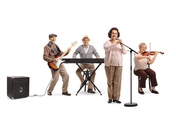 Senior people playing on guitar, violin and keyboard in a musical band