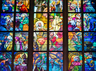 Colorful illustration on religious stained glass window