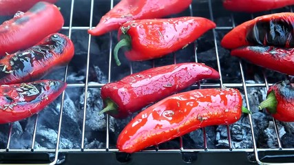 Fototapete - cooking process  red pepper on the grill