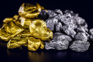 stones of gold and silver gross, mineral extraction of gold and silver. Concept of luxury and wealth.