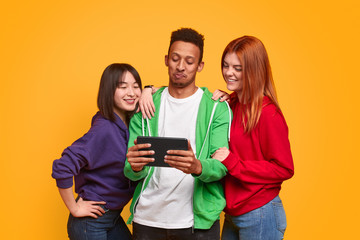 Multiethnic friends using tablet together