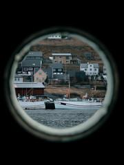 View of a port in Faroe Islands from boat window