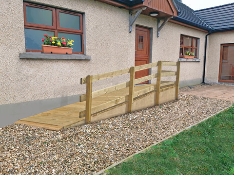 Wheelchair ramp over a step into house