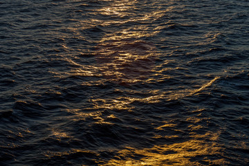Reflections on the waves of the Mediterranean sea at sunset