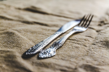 retro vintage cutlery knife and fork on antique tablecloth