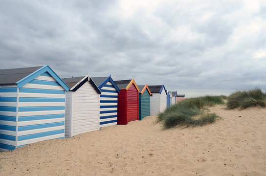 row of beach huts at southwold