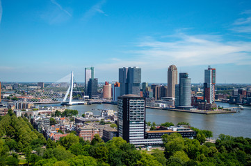 Scenic view of Rotterdam and Erasmus Bridge in the Netherlands as seen from the Euromast observation tower.