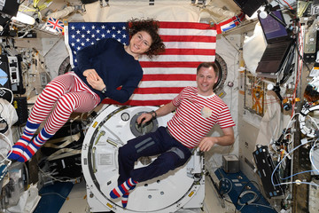 NASA handout photo of astronauts Christina Koch and Nick Hague are shown on the International Space Station sending a Fourth of July message home from space
