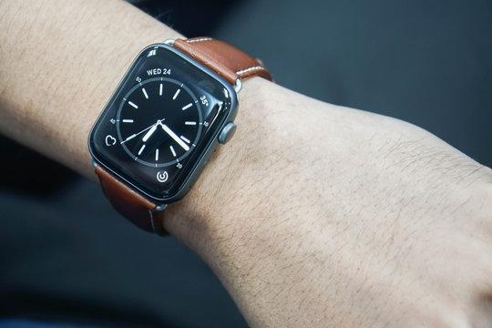 Bangkok / Thailand - close up apple watch screen on men wrist for timing