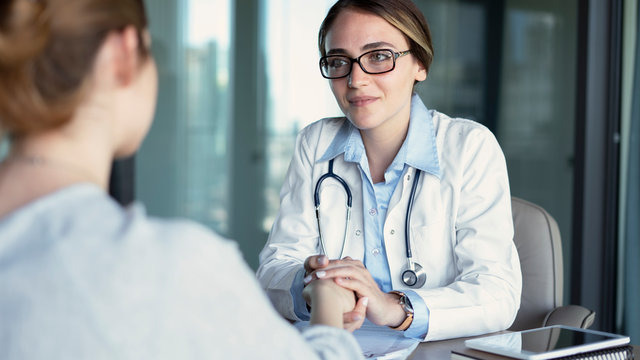 Doctor talking to the patient