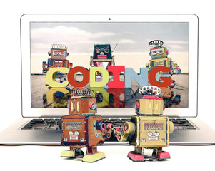 Wall Mural - two retro bobots learn about codeing on a laptop computer i