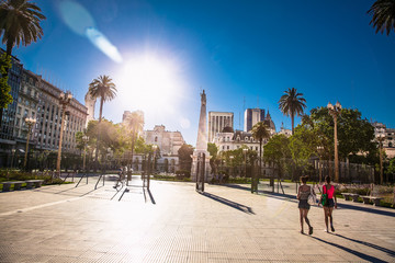 People walk on Plaza de Mayo square in Buenos Aires, Argentina.