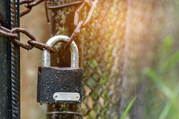 Padlock on the chain - the concept of protection