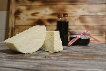 Beautiful, healthy and tasty feta cheese on a beautiful textured wooden background