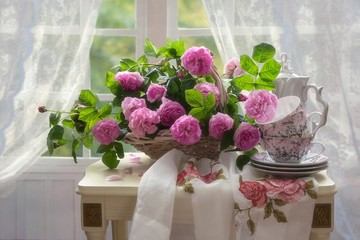 Still life with beautiful bouquet of pink roses in the interior