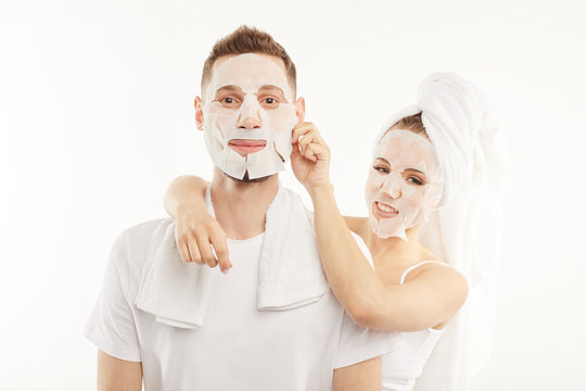 Man and woman use hygienic face masks.