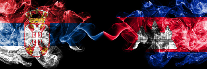 Serbia vs Cambodia, Cambodian smoky mystic flags placed side by side. Thick colored silky smokes combination of Serbian and Cambodia, Cambodian flag Fototapete
