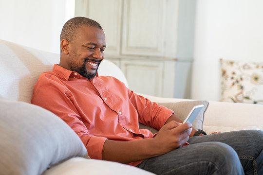 Mature black man using smartphone