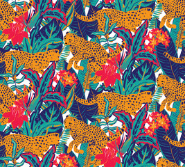 Vestor seamless pattern with jaguars, tropical leaves and flowers.