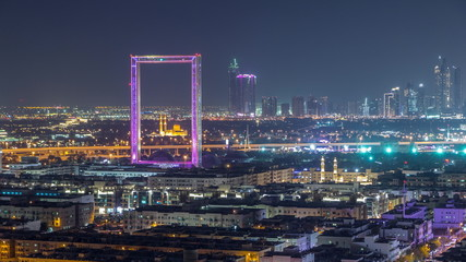 Dubai Frame with Zabeel Masjid mosque illuminated at night timelapse. Wall mural