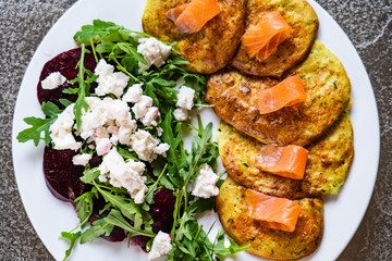 Pancakes with greek salad and salmon