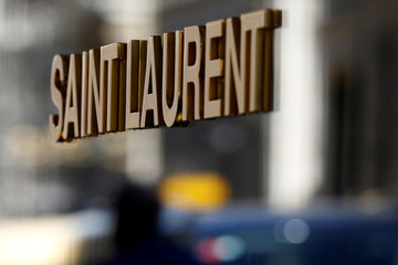The logo of Saint Laurent, a brand of French luxury group Kering, is seen in Paris