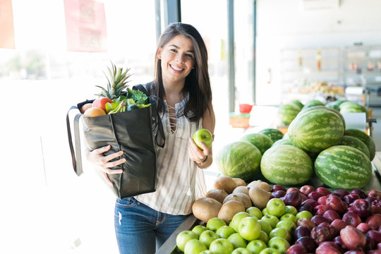 Mid Adult Customer Shopping Healthy Fruits At Market