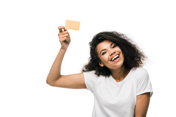 Fototapeta happy african american woman holding credit card isolated on white obraz