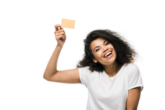 happy african american woman holding credit card isolated on white
