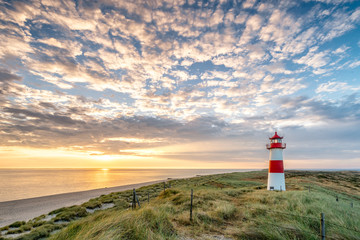 Foto op Canvas Bleke violet Red Lighthouse on the island of Sylt in North Frisia, Schleswig-Holstein, Germany
