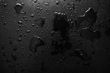 texture background water drops on a black background