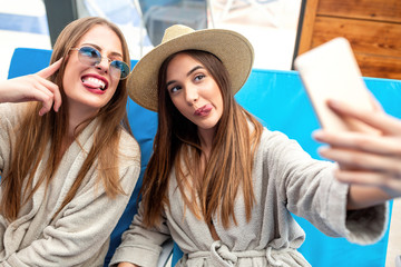 Two beautiful girls taking a selfie