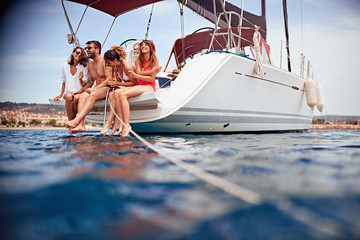 Happy people relaxing on the yacht deck. Fotomurales