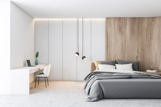 White and wood bedroom with home office