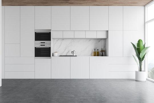 Minimalist white kitchen interior with countertops