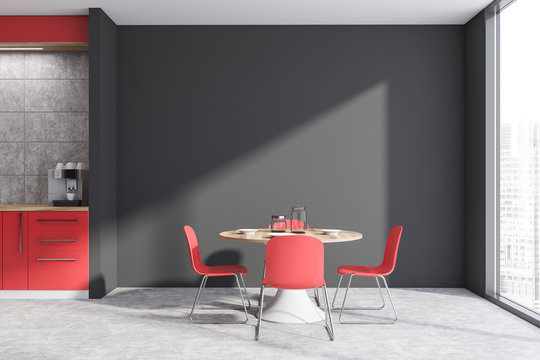 Red and gray kitchen interior with table