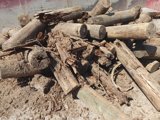 Pile of sandy timber as wooden building rubble after demolition