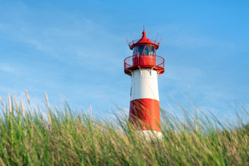 Wall Mural - Red lighthouse List Ost on the island of Sylt, North Frisian islands, Germany
