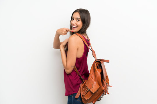 Young woman over isolated white background with backpack