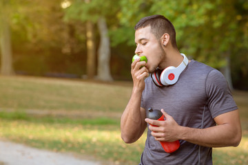 Runner young latin man eating an apple sports training fitness copyspace copy space