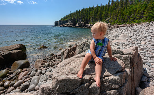 Boy in Acadia National Park on Boulder Beach