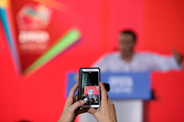 A supporter takes a picture of Greek PM and leader of leftist Syriza party Tsipras during his speech in a pre-election rally in Athens