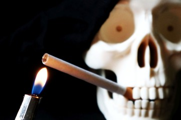 Skeleton skull with a cigarette in her mouth
