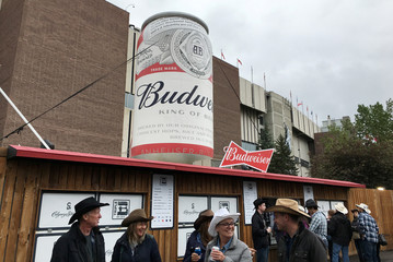 Visitors walk in the  concessions area where signs are posted baning the use of cannabis on the grounds during the Calgary Stampede in Calgary