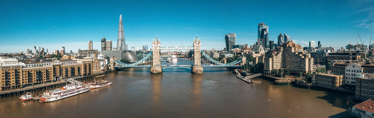 Wall Mural - Arial view of London with the River Thames near Tower Bridge, the Shard and Canary Wharf district at sunrise.