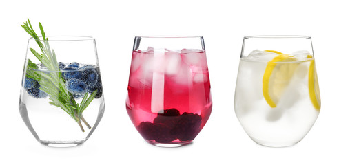 Fototapeta Set of glasses with different refreshing drinks on white background obraz