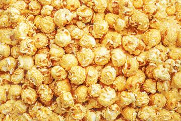 Popcorn Pattern. Caramel popcorn background. Food, cinema, movie or film design. Flat lay