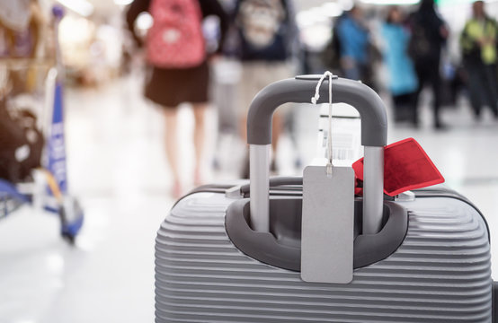 """Luggage holder tag blank label on suitcase / baggage put letter """"Travel insurance"""" word for display your products near combination locks for traveling luggages in airport terminal, copy space for text"""