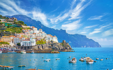 Beautiful Amalfi on hills leading down to coast, comfortable beaches and azure sea on Amalfi Coast in Campania, Italy